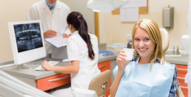 Dental office smiling female patient